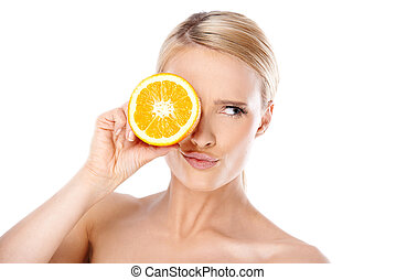 Young Woman Putting Slice of Lemon Over the Eye - Close up ...