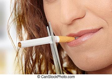Young woman quiting smoking