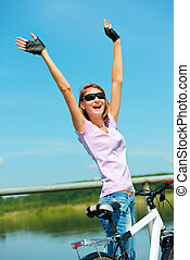 Young woman raised her hands up in joy