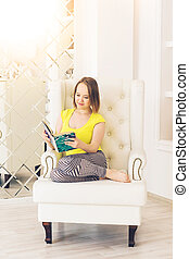 Young Woman Reading a Book at home