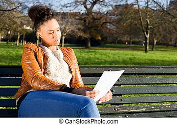 young woman reading a document