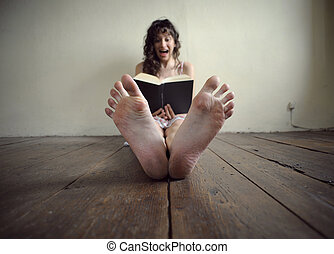 horror book - young woman reading a horror book
