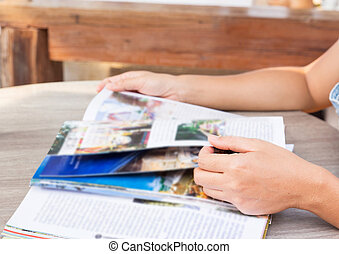 Young woman reading a magazine.