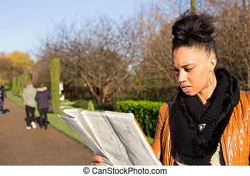 young woman reading a map.