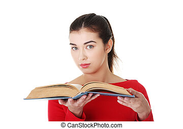 Young woman reading an old book