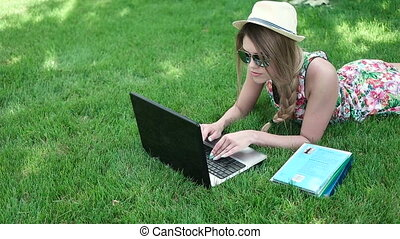 Young Woman Reading Book On Laptop