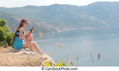 young woman reading e-book