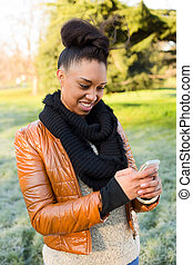 young woman reading her text message
