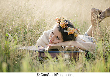 Young woman reading in nature