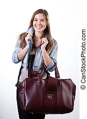 Young woman ready to go for a short travel