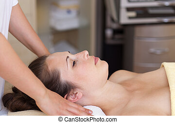 Young woman ready to receive a massage - Relaxed young woman...