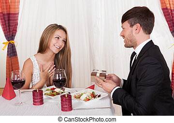 Young woman receives a gift