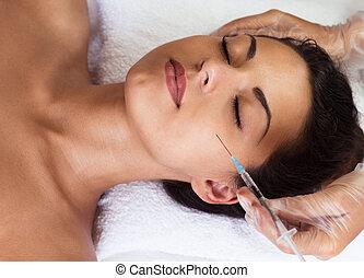 Young woman receiving cosmetic injection - Beautiful woman...