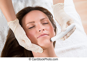 Woman Receiving Microdermabrasion Therapy - Young Woman...