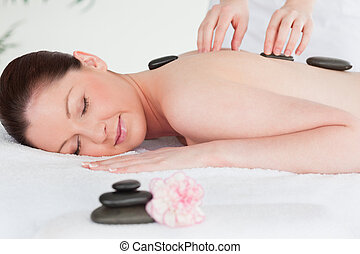 Young woman receiving Stone therapy