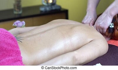 young woman reciving relxing massage in spa salon