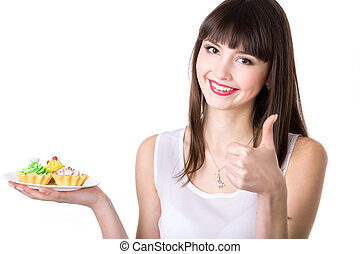Young woman recommending cakes