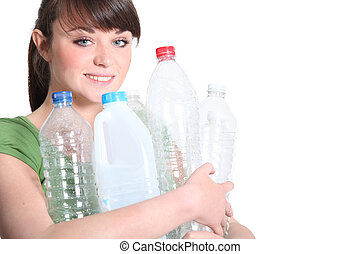 young woman recycling plastic