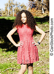Young Woman Red Dress Standing Outside On Grass