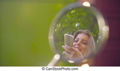 Young woman reflection in the rear view mirror