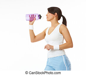 Young woman refreshing after training