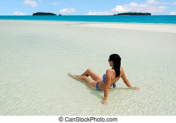 Young woman relax on Aitutaki Lagoon Cook Islands