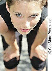 Young woman relaxing after running - Young person (woman) ...