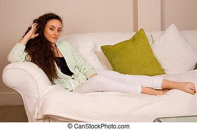 young woman relaxing at home.