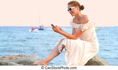 Young Woman Relaxing at Seaside