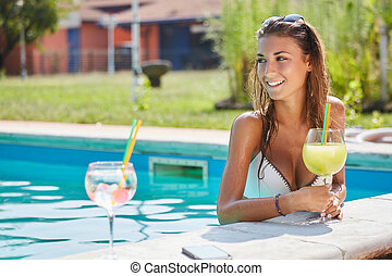 young woman relaxing at swimming po