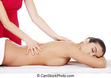 Young woman relaxing beeing massaged
