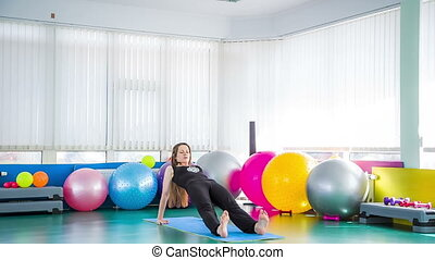 Young Woman Relaxing By Doing Stretching Exercises