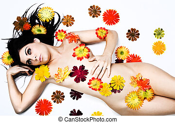 Young woman relaxing covered in flowers