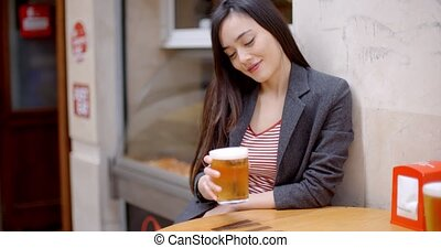 Young woman relaxing enjoying a beer