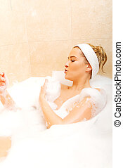 Young woman relaxing in bath