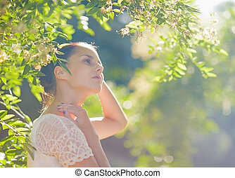 Young woman relaxing in forest