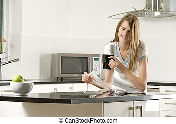 Young woman relaxing in her kitchen