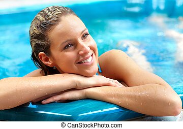 Young woman relaxing in jacuzzi.