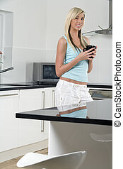 Young woman relaxing in kitchen
