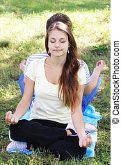 Young woman relaxing in yoga pose