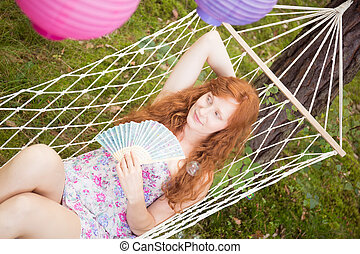 Young woman relaxing on a hammock