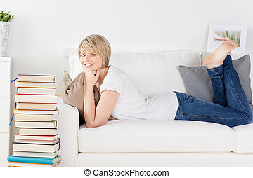 Young woman relaxing on a sofa