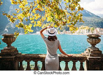 Young woman relaxing on beautiful Garda lake. vacation...