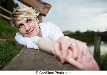 Young Woman Relaxing On Bench