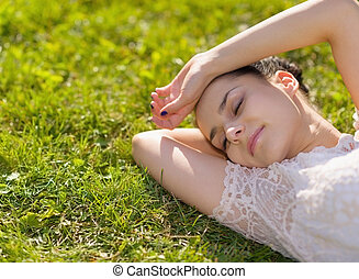 Young woman relaxing on grass