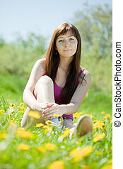 woman relaxing outdoor in grass
