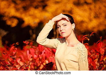 young woman relaxing walking in autumnal park.