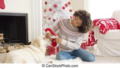 Young woman relaxing with her dog at Christmas