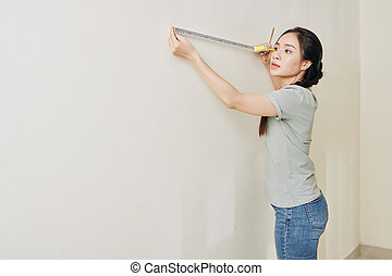 Young woman renovating house