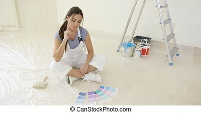 Young woman renovating or decorating her new home